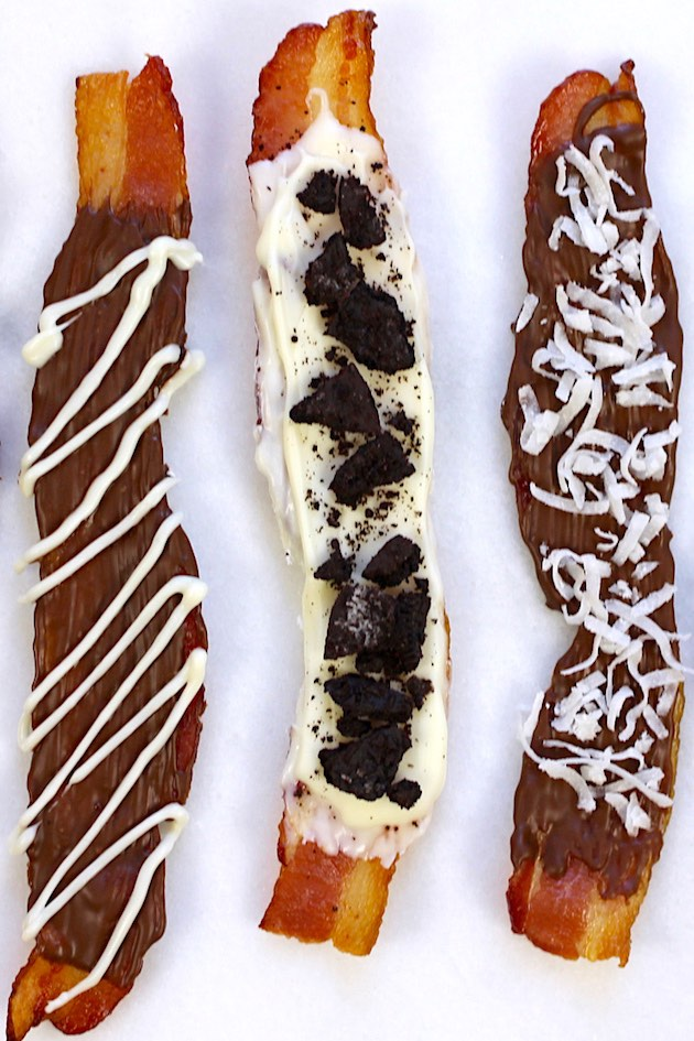 Overhead view of this chocolate covered bacon recipe with white chocolate drizzle, crushed oreos and shredded coconut as toppings