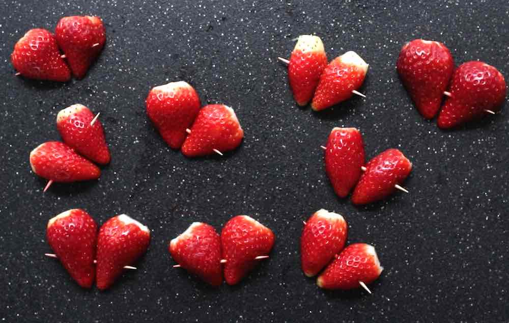 Chocolate Covered Strawberry Hearts held together with toothpicks