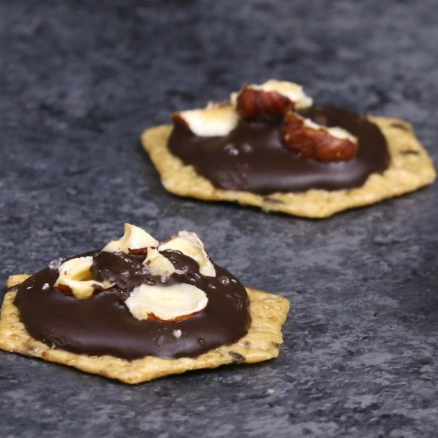 Chocolate hazelnut cluster party appetizers made with melted chocolate, crushed filberts an Crunchmaster crackers