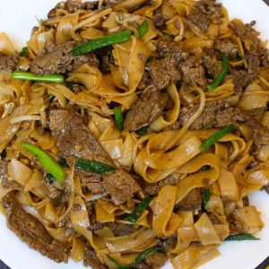 This amazing Beef Chow Fun is surprisingly easy to make at home in under 30 minutes. It's loaded with extra wide ho fun rice noodles, tender beef slices and flavorful vegetables, all tossed in a delicious homemade chow fun sauce that tastes like it came from your favorite Chinese restaurant.