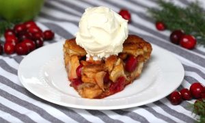 This Cinnamon Roll Apple Cranberry Pie recipe is an easy to make dessert that everyone will love