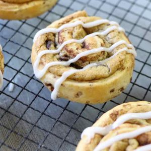 Homemade chocolate chip cinnamon rolls with icing on top made with just 3 ingredients