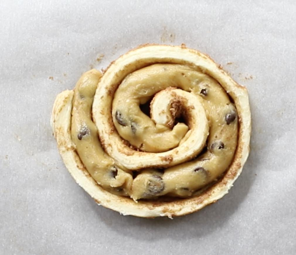 Fitting cookie dough into a cinnamon roll spiral when making cinnamon roll cookies