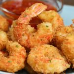 Coconut Shrimp on a serving plate with an Asian sweet chili dipping sauce