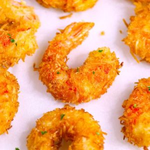 These Coconut Shrimp make an irresistible appetizer that's tender on the inside, and crispy, sweet and crunchy on the outside. They're mouthwateringly delicious and will be the first to go at a party! Plus recipe video tutorial!