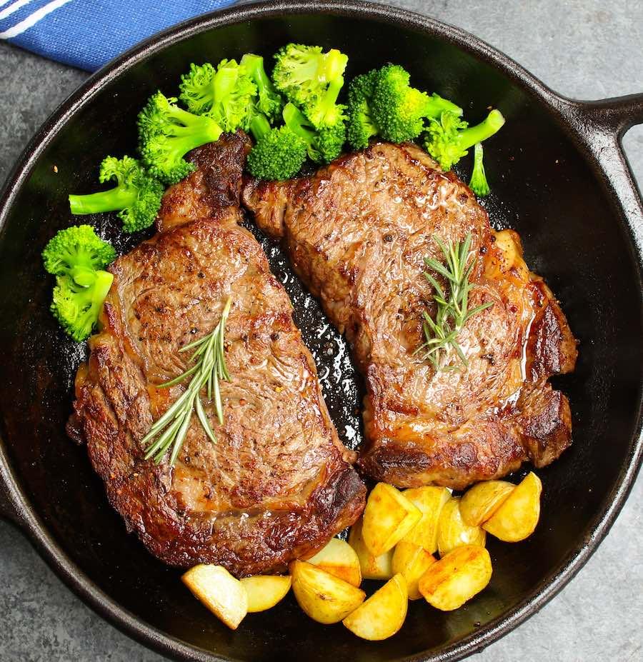 Comparison of cooked bone-in rib and boneless rib eye steak