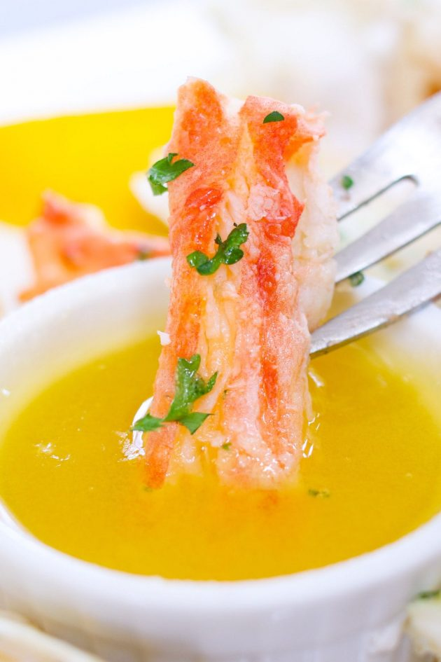 Dipping crab legs in clarified butter.