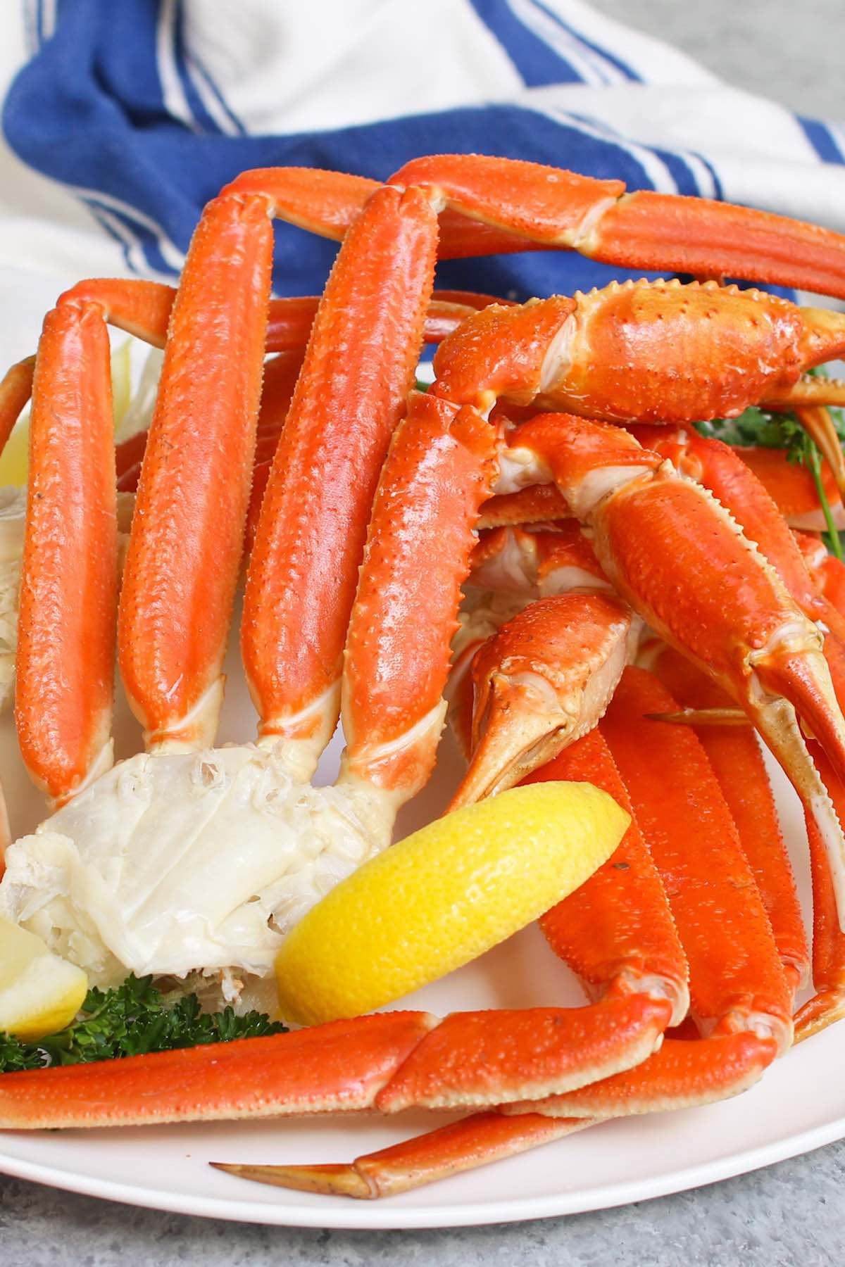 Learn how to cook crab legs for a delicious meal bursting with seafood flavors! Whether you're using frozen king crab or snow crab legs,  follow this essential step-by-step guide on how to easily cook them in just 15 minutes by steaming, boiling, baking or grilling.