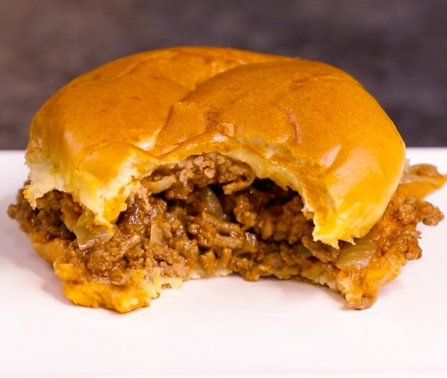 A meaty sloppy joe after taking a bite out of it