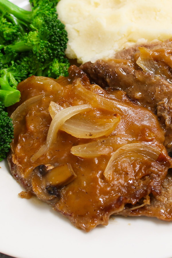 Crock Pot Cube Steak and Gravy made with tender and succulent cubed steak smothered in a rich and divine mushroom sauce in a slow cooker. Serve it with mashed potatoes and green vegetable, and then drizzle with the thick and flavorful gravy for a perfect home-style dinner!