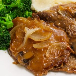 Crock Pot Cube Steak and Gravy made with tender and succulent cubed steak smothered in a rich and divine mushroom sauce in a slow cooker.