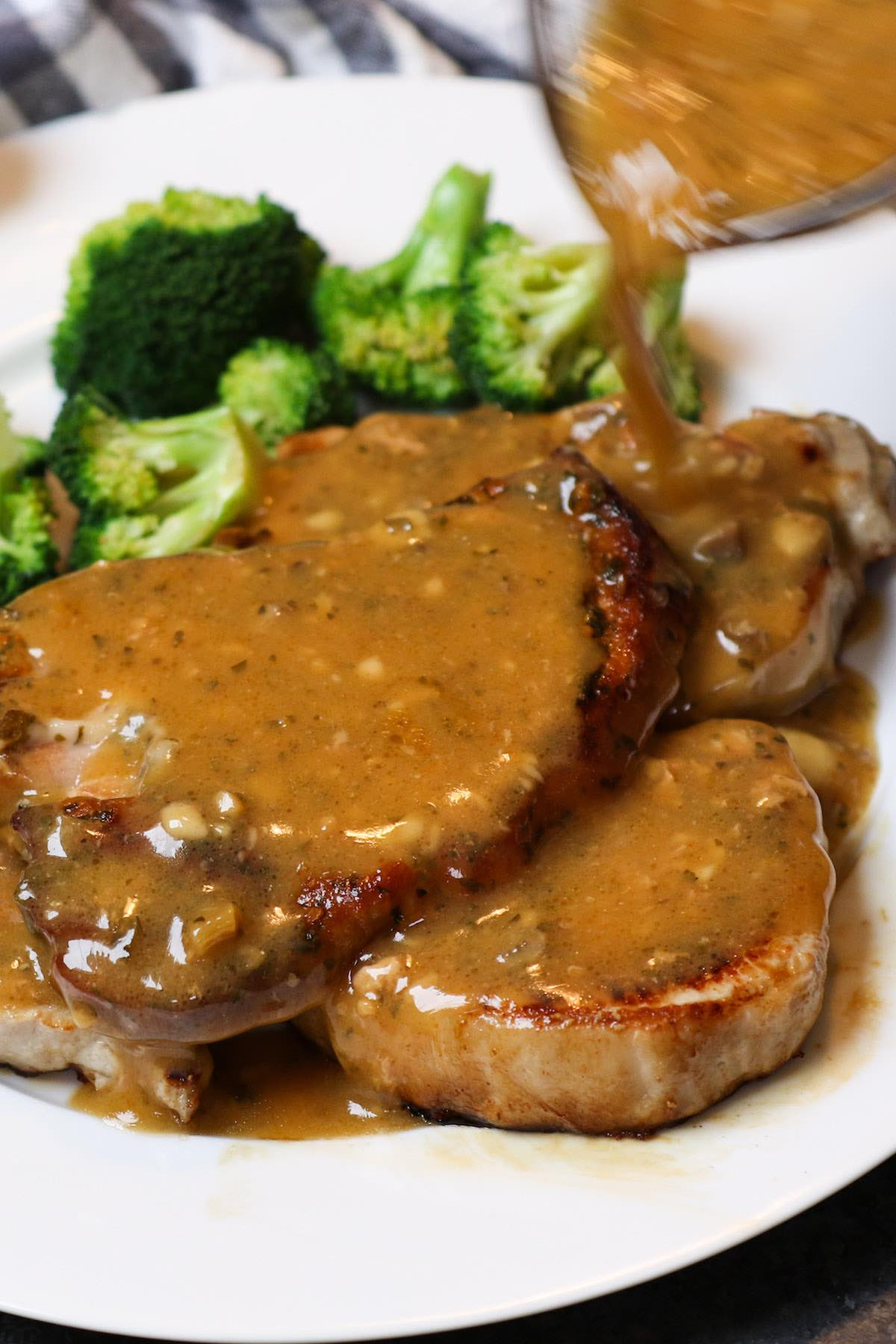 Drizzling gravy from the slow cooker onto crock pot ranch pork chops
