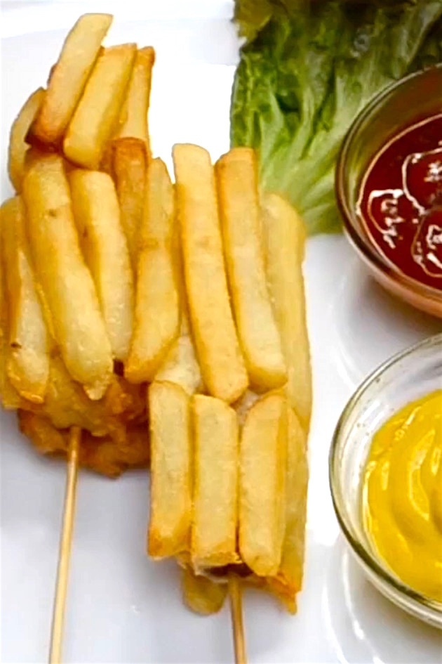Hot dogs battered and coated in french fries before being deep fried to golden perfection. Perfect for a party