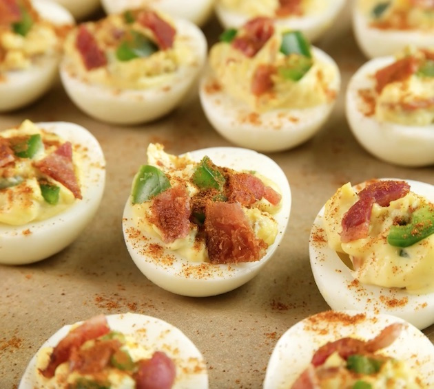 This photo shows the final steps in preparing Deviled Eggs with Bacon before serving
