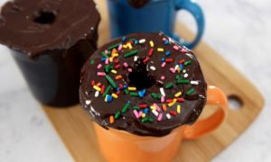 5 Minute Donut Mug Cake – A creamy, fluffy, delicious cake in a mug, ready in 5 minutes. It only requires a few simple ingredients: flour, sugar, baking powder, oil, milk, vanilla, chocolate chips, cream and nutmeg. So good and easy to make for the perfect dessert or snack. No bake. Vegetarian. Video recipe. | tipbuzz.com