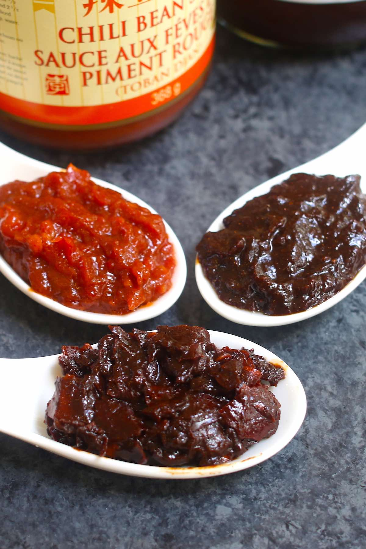 Doubanjiang is a Chinese bean paste with savory and sometimes spicy accents that makes many popular Chinese stir-fry recipes. Learn about the different types of Doubanjiang, how to use it, recommended brands, substitutes and more!