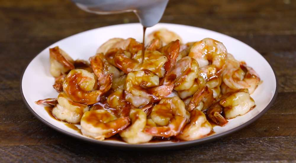 Drizzle thickened teriyaki sauce onto the cooked shrimp
