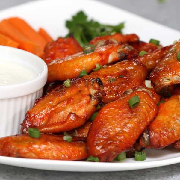 Easy Game Day Chicken Wings on a serving plate with carrot sticks and dipping sauce