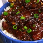 Tender and juicy beef smothered in an addictive sticky, slightly sweet and savory ginger garlic sauce.