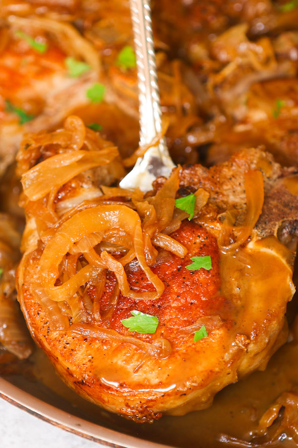 A southern style smothered pork chops are tender, juicy and full of flavor, with extra sauce to serve with your pork chops and sides. Nothing compares to this super fast and easy smothered pork chops! Perfect for weeknight or weekend cooking.