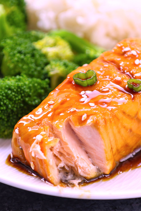 Teriyaki Salmon served on a plate with broccoli and rice