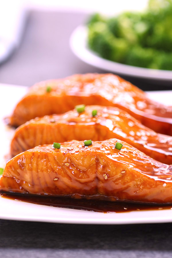 This Teriyaki Salmon is flaky, juicy and pan-fried to perfection with homemade Teriyaki Sauce. It's the easiest, most flavorful teriyaki salmon you'll ever eat. A healthy weeknight dinner option that's ready in 20 minutes. Video recipe! #TeriyakiSalmon
