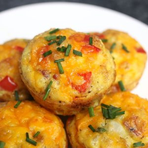 These freezer-friendly Egg Muffins are made with eggs, cheese, bacon, spinach, onions, and bell peppers. An easy make-ahead recipe, they only take a few minutes to throw together. These breakfast muffins are delicious, healthy and nutritious, perfect for busy mornings!