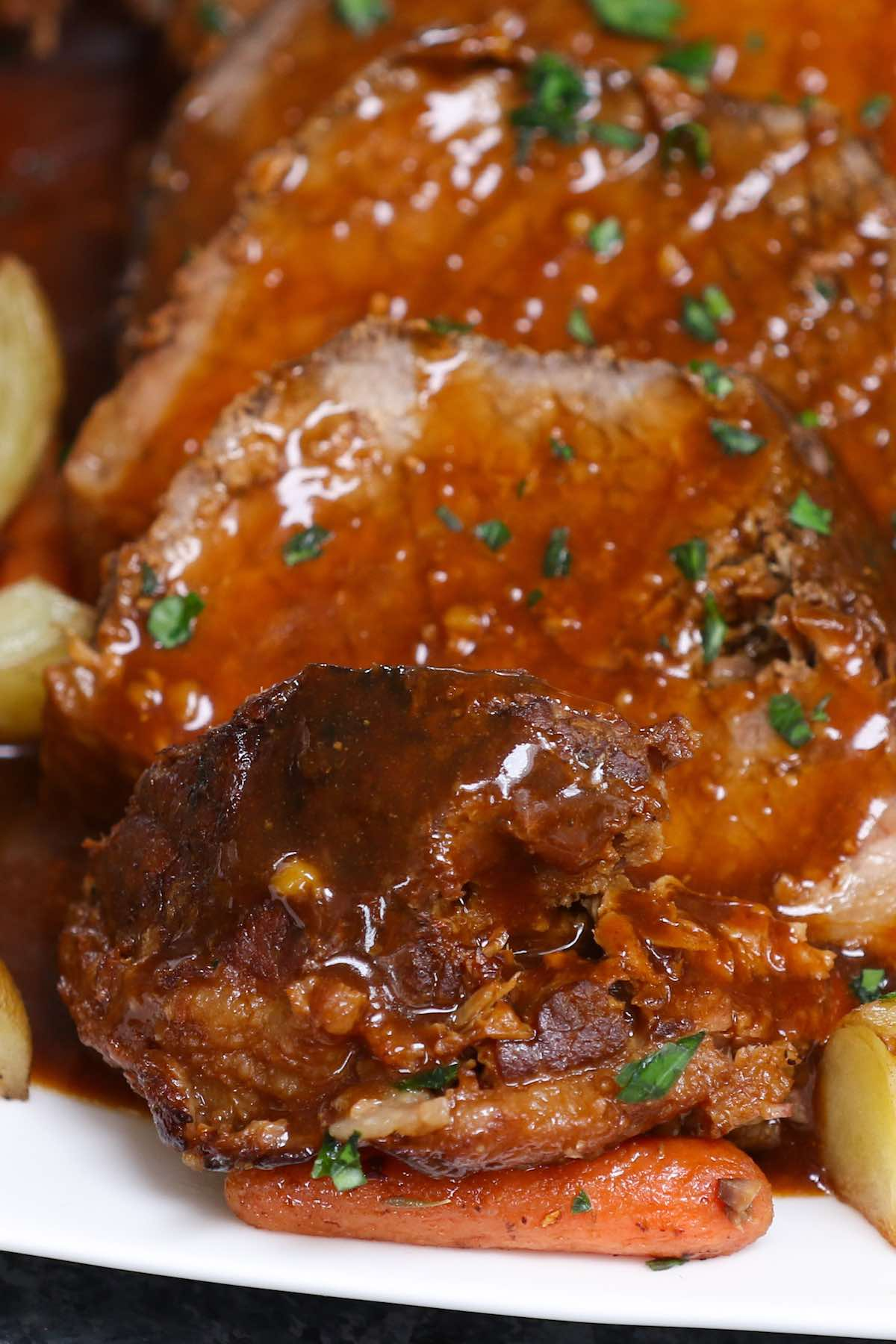 Closeup of roast beef with gravy on top