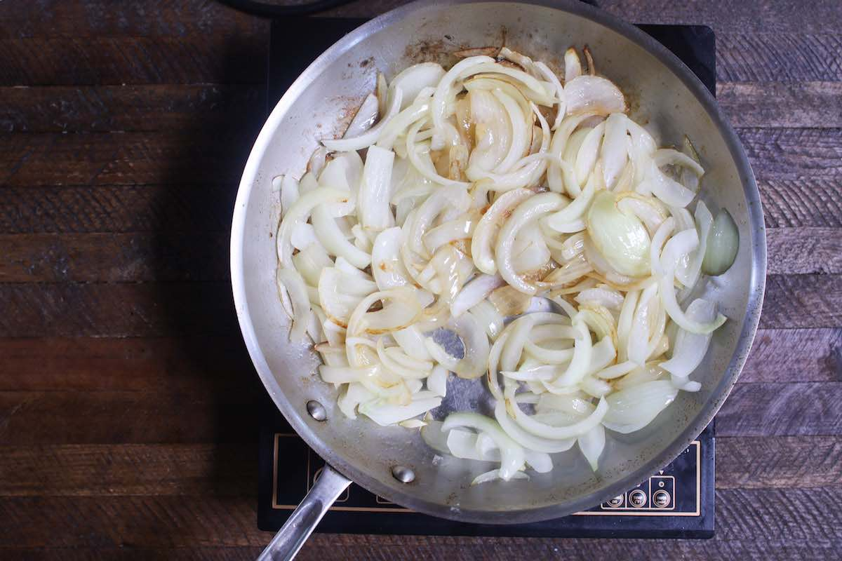 Sautee sliced onions in a pan