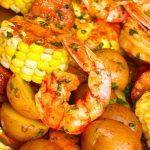 Shrimp Boil in Foil Packets - a delicious shrimp boil recipe you can make at home in foil packets with corn, potatoes and sausage. So delicious. Video recipe