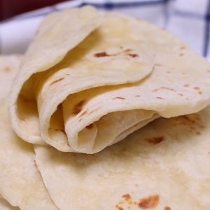 Homemade Flour Tortillas are soft, tender and fluffy – a delicious Mexican thin flatbread made from scratch! It's easy to make with only 5 simple ingredients, and can be done completely by hand!