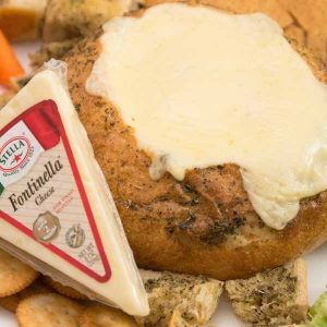 Stella's Fontinella cheese goes into melty perfection on this Cheese Fondue in a Bread Bowl recipe
