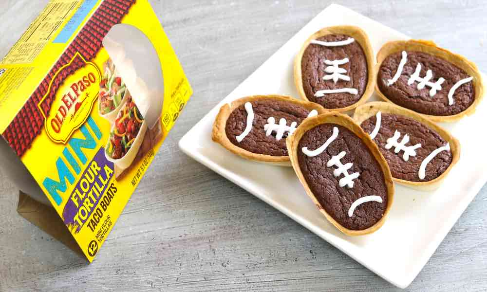 This Football Brownie Taco Boats recipe using Old El Paso for a tailgate theme