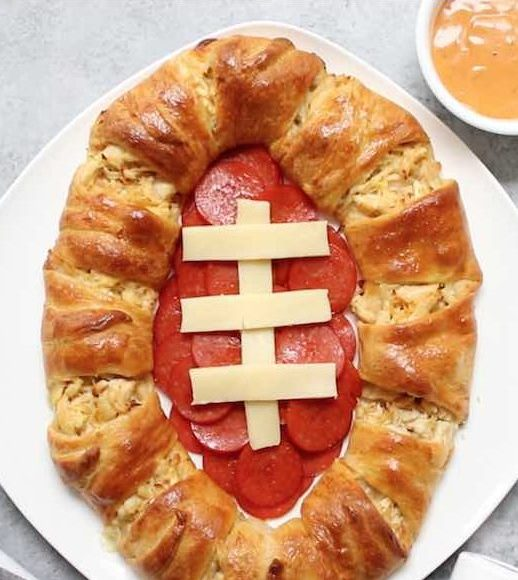 A homemade Chicken Crescent Ring with a Game Day theme