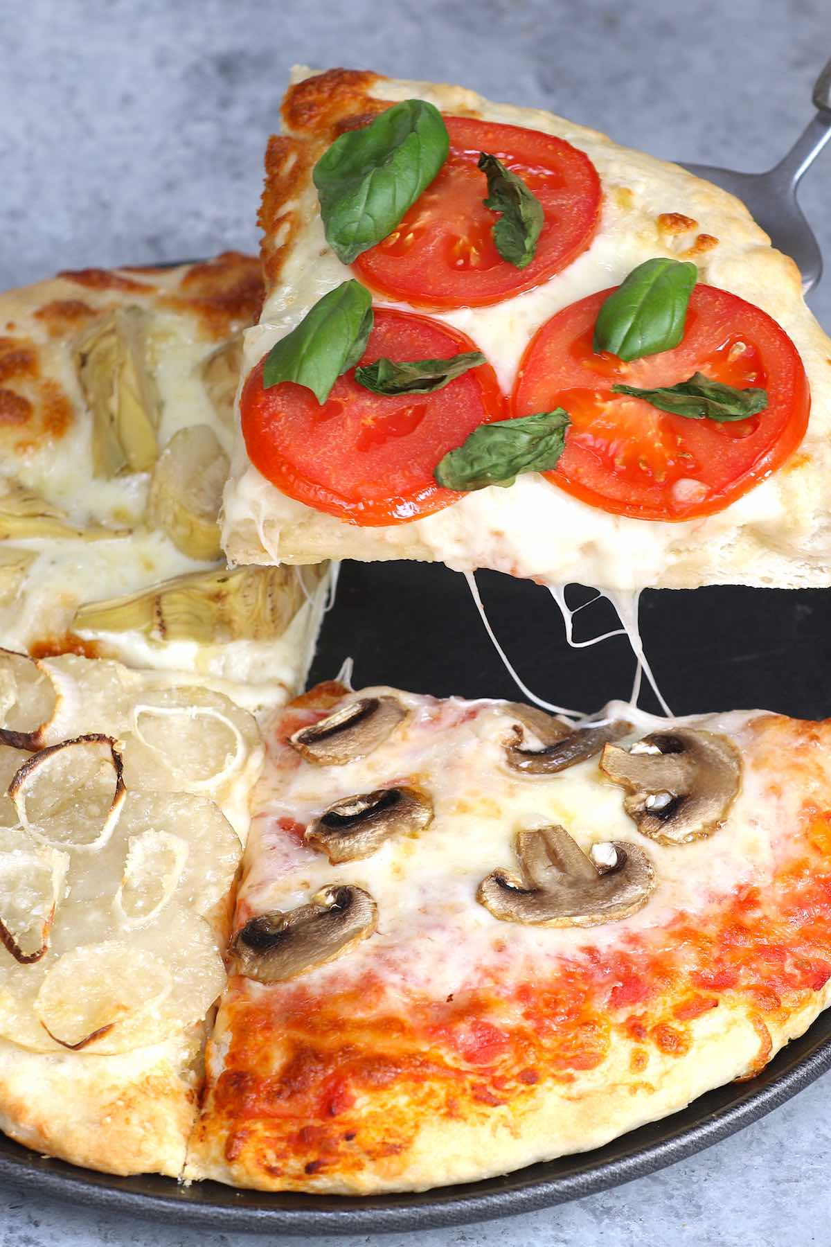 Four Seasons Pizza is divided into sections with different toppings representing the four seasons. This classic Italian recipe starts with homemade pizza dough and fresh ingredients for the best flavor. It's so much fun to make and eat!