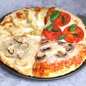 Four Seasons Pizza is divided into sections with different toppings representing the four seasons. This classic Italian recipe starts with homemade pizza dough and fresh ingredients for the best flavor.