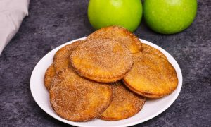 Fried Apple Pies - soft and sweet on the inside and crispy and flaky on the outside, the easiest dessert that takes less than 20 minutes! Totally irresistible! All you need is a few simple ingredients: apples, lemon, cinnamon sugar, butter, tortillas and egg. Plus Video recipe! Tipbuzz.com #friedApplePie