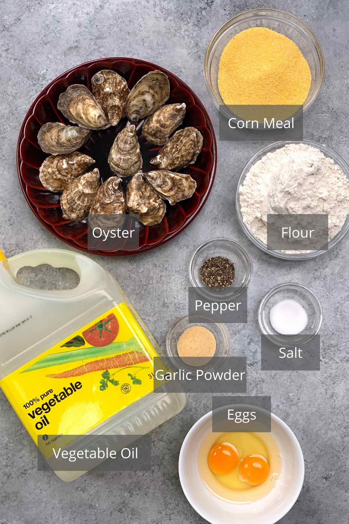 Overhead view of the ingredients for making fried oysters