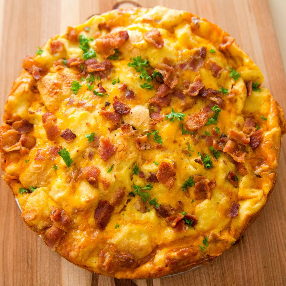 A fluffy and perfect Frittata – loaded with bacon, cheese, eggs and vegetables. Once you know the basics, the filling options are endless. It takes less than 20 minutes and is a great recipe to clean out the refrigerator!