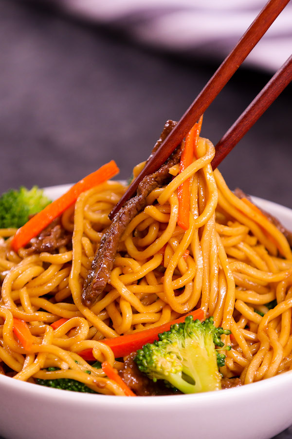 Eating Garlic Beef Lo Mein with chopsticks
