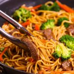 Garlic Beef Lo Mein – Tender beef cooked with colorful vegetables and delicious Lo Mein noodles with addictive garlicky sauce. This 20 minute one pan Lo Mein is a perfect quick and easy weeknight dinner recipe and so much better than takeout. Plus recipe video!