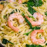 This Garlic Butter Shrimp Pasta is a simple and incredibly delicious one pot meal you can make in under 30 minutes. Tender and juicy shrimp are cooked in a garlicky and buttery sauce before being tossed with baby spinach and freshly grated parmesan. It's a quick and easy dish that's restaurant quality. #ShrimpPasta