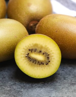 Closeup of a golden kiwi cut in half