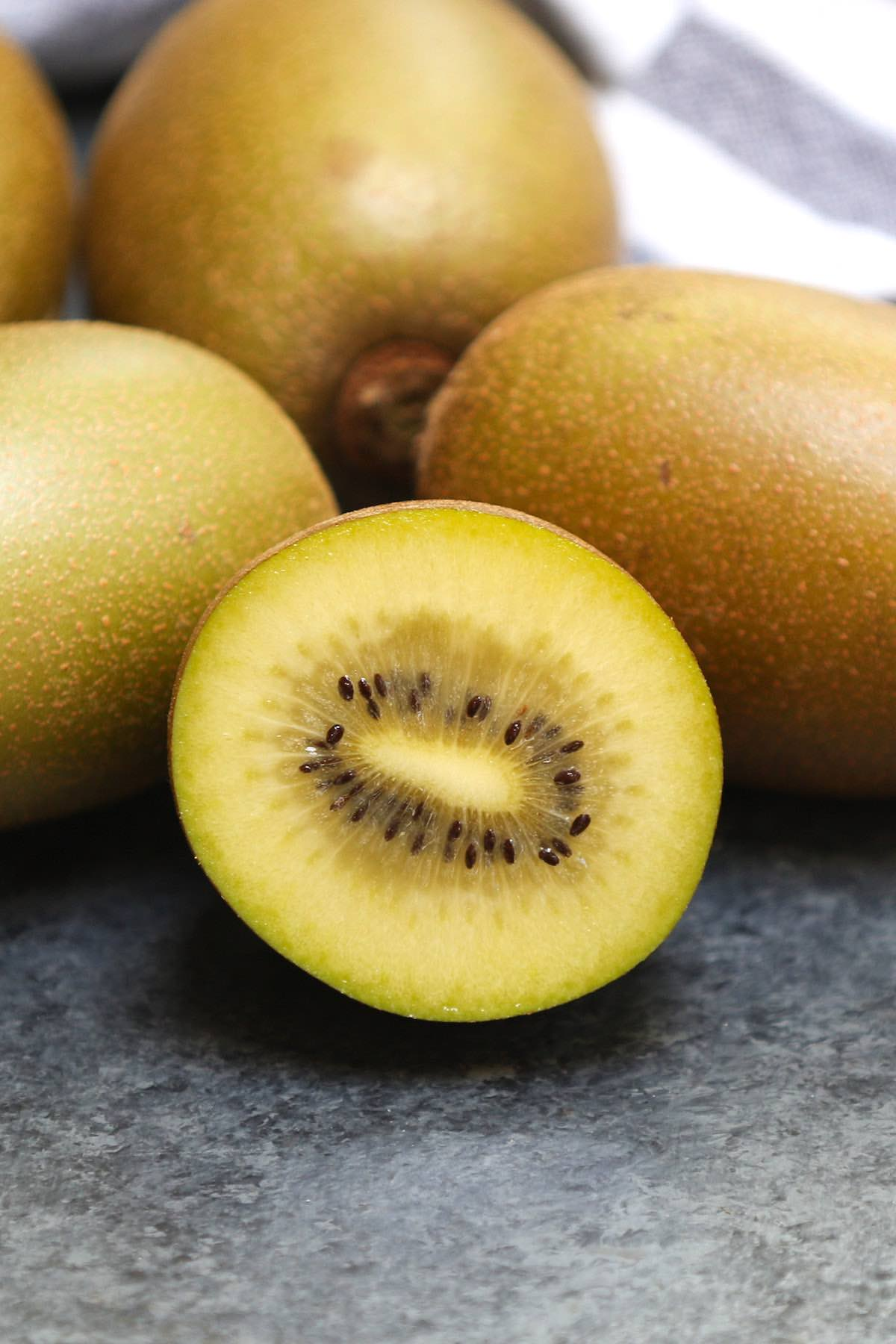 Closeup of a golden kiwi cut in half