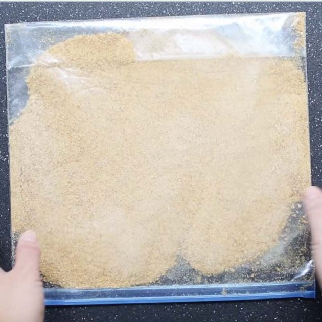 Pulverized graham cracker crumbs in a resealable plastic bag