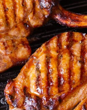 These Grilled Pork Chops are a surefire hit for any weeknight dinner or backyard BBQ, and they're easy to make with just 5 ingredients. Your entire family will love these tender and juicy pork chops!