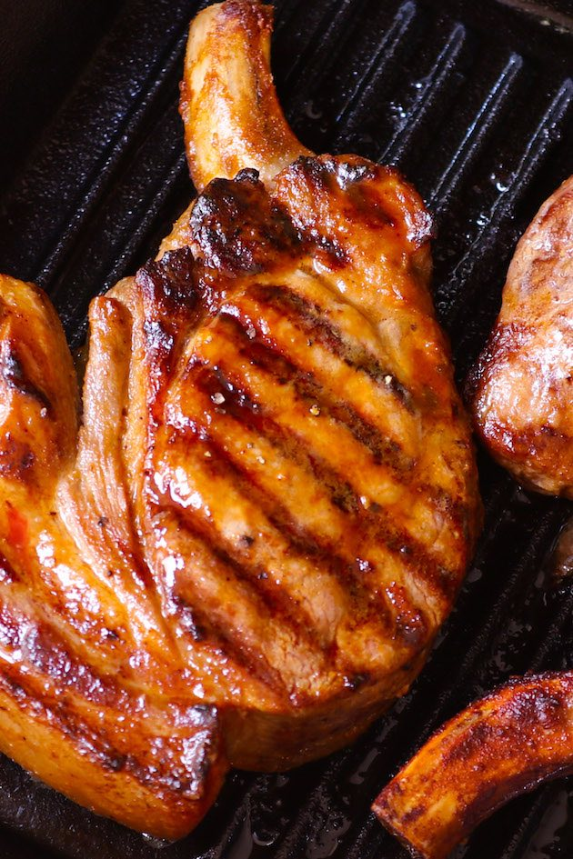 Grilled Pork Chops are tender and moist marinated pork chops grilled to golden perfection. Cook on a hot barbecue for a fast meal ready in under 30 minutes.