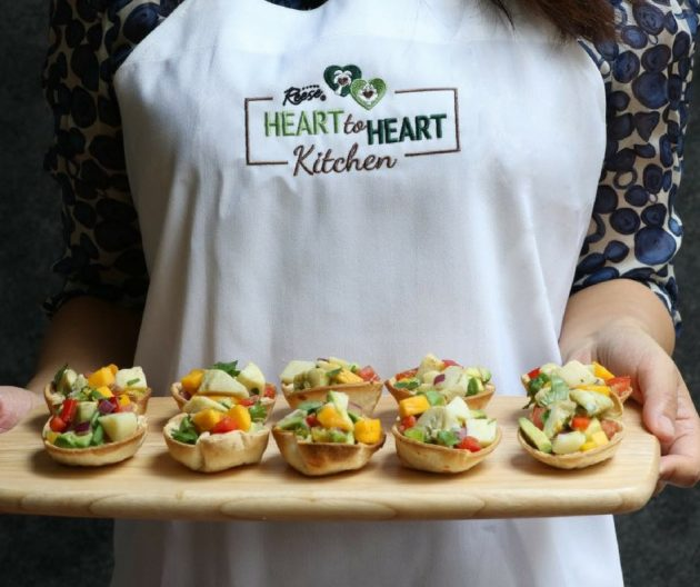 This photo shows hearts of palm ceviche cups, a bowl of the ceviche salad filling and Reese brand hearts of palm and artichoke hearts packages used to prepare the recipe