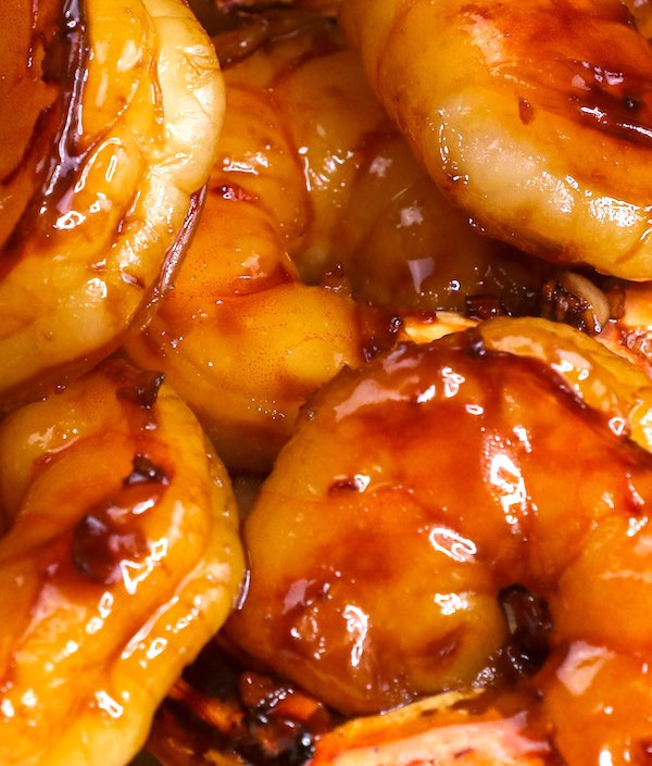 Honey garlic shrimp - here is a closeup of shrimp coated in a delicious honey garlic sauce that forms a mouthwatering glaze for this dish