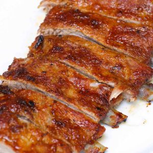 Oven baked back ribs on a serving plate